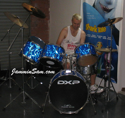 Photo of Mick Heck's Pearl drum set with Blue Satin Flame drum wrap