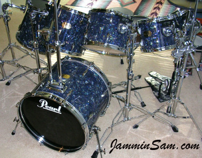 Photo of Kirk Yost's Pearl Export drum set with Dark Abalone Pearl drum wrap