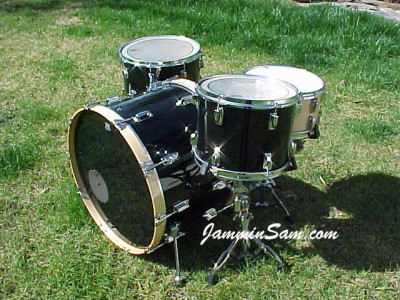 Photo of Mark Manausa's Tama Imperial drums with JS Solid Black drum wrap (2)