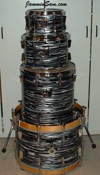 Photo of Fin Park's Trak drums with Retro Black Oyster Pearl drum wrap