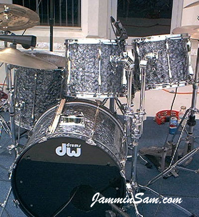 Photo of Charlie Glasgow's Pearl Export drums with 80's Black Diamond Pearl drum wrap