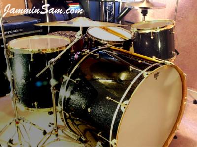 Photo of Matt Shelley's custom drums with Vintage Black Sparkle drum wrap