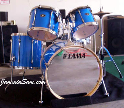 Photo of Jason Smith's Tama Superstar drums with JS Hi Gloss Tropical Blue drum wrap