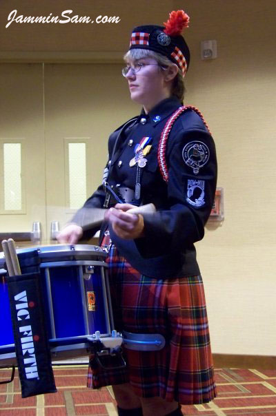 Photo of Sara-jo Fegley's Premier marching drum with JS Hi Gloss Tropical Blue drum wrap (2)
