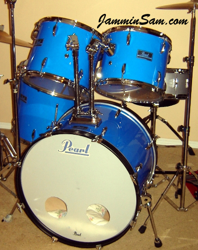 Photo of Scott McLaren's Pearl drums with JS Hi Gloss Tropical Blue drum wrap