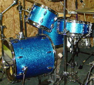 Photo of Johnny Bongo's drums with Blue Metal drum wrap
