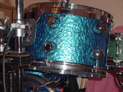 Photo of Mark Kantor's tom with Blue Metal drum wrap (1). (may be known as hand hammered metal)