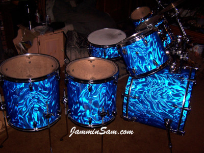 Photo of Jim Reese drum set with Blue Satin Flame drum wrap