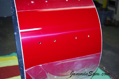 Photo showing the protective layer on this JS Hi Gloss Bright Red drum wrap (08)
