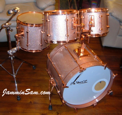 Photo of Joe Mekler's Sonor drums with Champagne Pink drum wrap (1)