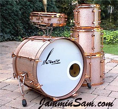 Photo of Joe Mekler's Sonor drums with Champagne Pink drum wrap (2)