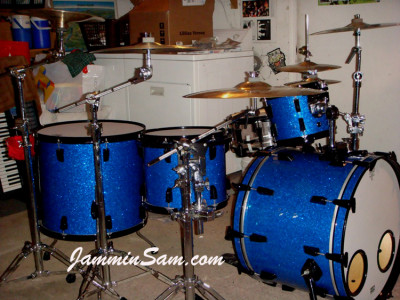 Photo of Chris Amato's Pearl drum set with Deep Blue Glass Glitter drum wrap (1)