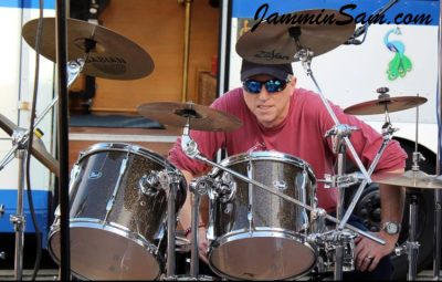 Photo of Sven Bridstrup with his Pearl Export drums wearing Root Beer Glass Glitter drum wrap