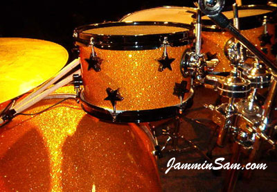 Photo of John Langdon's drum kit with Gold Glass Glitter drum wrap. Also be known as crushed glass
