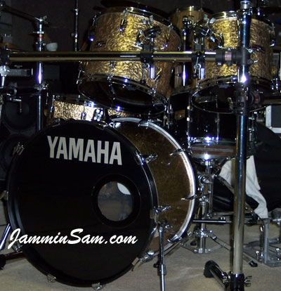 Photo of Ron Miller's Yamaha drums with Gold metal drum wrap (2). Could also be known as hammered metal.