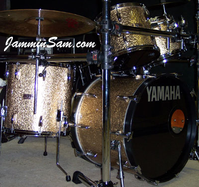 Photo of Ron Miller's Yamaha drums with Gold Metal drum wrap. May also be known as hand hammered metal