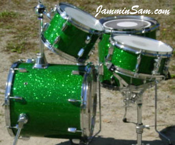Photo of Johnny Bongo's drum kit with Green Glass Glitter drum wrap. Also known as crushed glass.