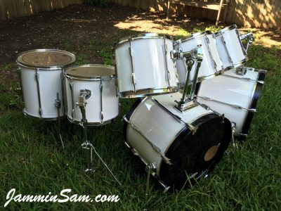 Photo of Travis Nelson's Pearl Export series with JS Hi Gloss White drum wrap (1)