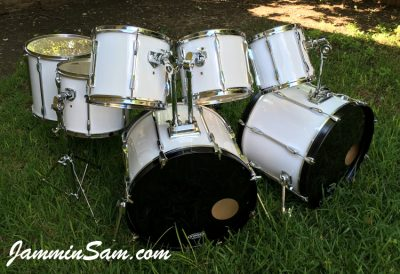Photo of Travis Nelson's Pearl Export series with JS Hi Gloss White drum wrap (3)