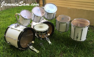 Photo of Travis Nelson's Pearl Export series with JS Hi Gloss White drum wrap (4)