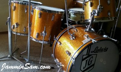 Photo of Jon Glenn's Ludwig set of drums with JS Sparkle Gold drum wrap (50)