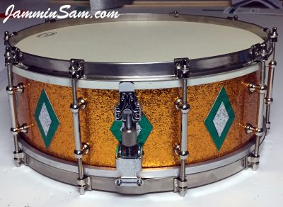 Photo of Rob Schmidt's Ludwig snare drum with JS Sparkle Gold drum wrap (2)