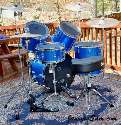 Photo of Zorri Berríos's drum set with JS Blue Sparkle drum wrap (79)