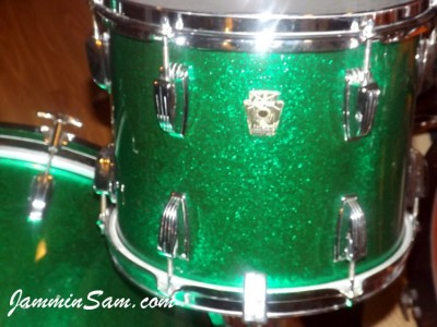 Photo ofKeith McAlexander's Ludwig drum set with JS Sparkle Green drum wrap (50)