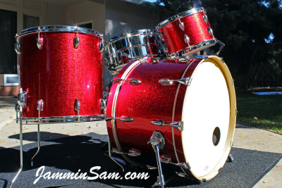 Photo of Marc Membreno's drum set with JS Sparkle Red drum wrap (2)