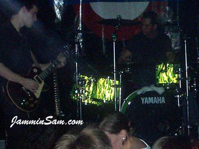 Photo of Chris Winder's Yamaha drum set with Neon Lime Satin drum wrap