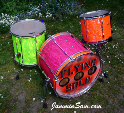 Photo of Brynley Rossiter's drums, one with Neon Pink Satin drum wrap (1)