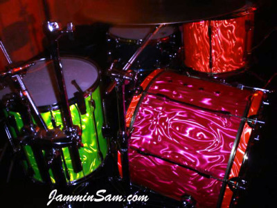 Photo of Brynley Rossiter's drums, one with Neon Pink Satin drum wrap (6)
