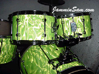 Photo of Phillip Doorman's Mapex drumset with Neon Lime Satin drum wrap (5)