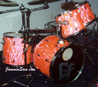 Photo of Teddy Stillwell's drums with Neon Orange Satin drum wrap