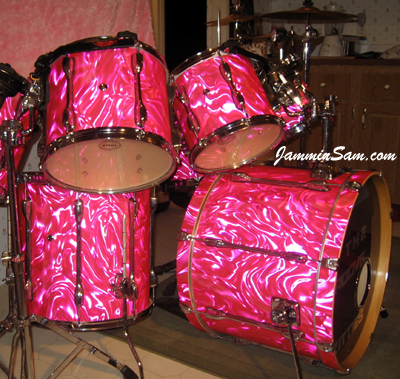 Photo of Garrison Bailey's Tama drums with Neon Pink Satin drum wrap (3)