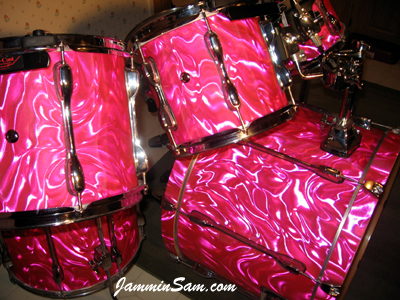 Photo of Garrison Bailey's Tama drums with Neon Pink Satin drum wrap (4)