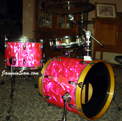 Photo of Jimmy Rehn's drums with Neon Pink Satin drum wrap