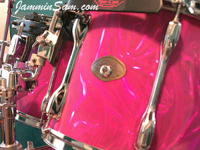 Photo of Mitch Trahan's Tama drums with Neon Pink Satin drum wrap (37)