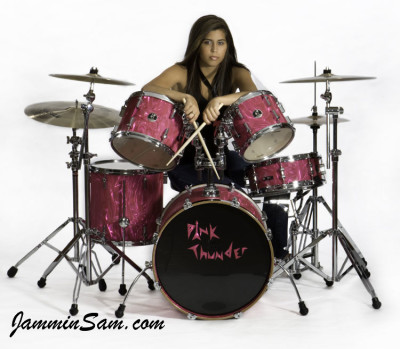 Photo of Olivia Adlakha's drums with Neon Pink Satin drum wrap (1)