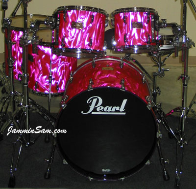 Photo of Paul Fredrick's Pearl drums with Neon Pink Satin drum wrap