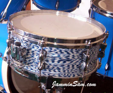Photo of Jason Smith's Tama snare with Onyx Blue White Pearl drum wrap