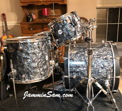 Photo of Phillip Ryan's DW Design Series set of drums with Vintage Black Diamond Pearl drum wrap (80)