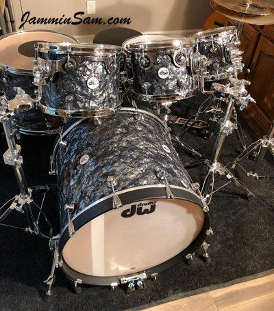 Photo of Phillip Ryan's DW Design Series set of drums with Vintage Black Diamond Pearl drum wrap (83)
