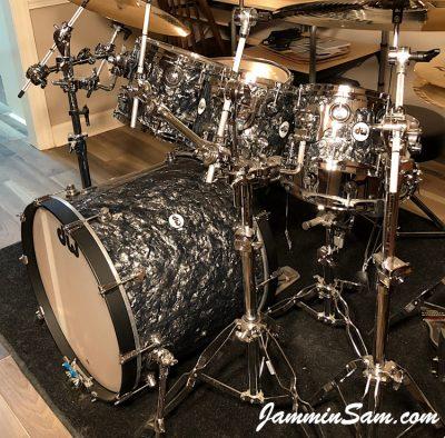 Photo of Phillip Ryan's DW Design Series set of drums with Vintage Black Diamond Pearl drum wrap (85)