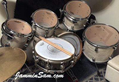 Photo of Chris Burns's set of Pacific CX drums with Aged 60's White Pearl (Yellowed) drum wrap (2)