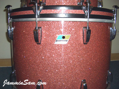 Photo of Alan Takaoka's Ludwig drums with Pink Glass Glitter drum wrap (2)