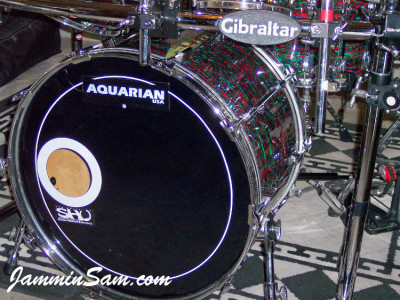 Photo of Anthony Divozzo's rack mounted drums with Psychedelic Red drum wrap (11)