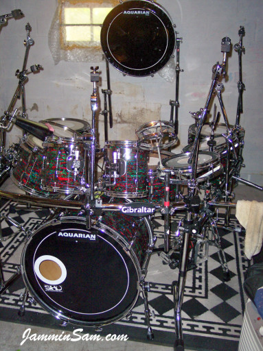 Photo of Anthony Divozzo's drum set with Psychedelic Red drum wrap (12)