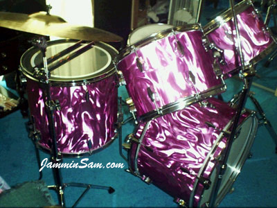 Photo of Rick Hilbrich's Fibes drum set with Purple Satin Flame drum wrap (1)