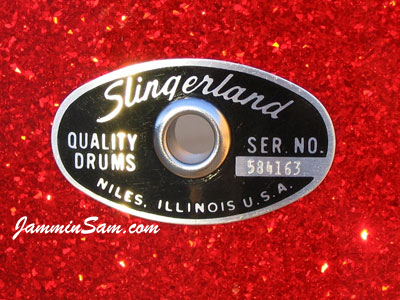 Photo of Mark Fenberg's Slingerland eyelet and badge on a Red Glass Glitter drum wrapped drum